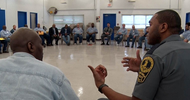 Virginia State Police officer speaks to offenders at State Farm Correctional Center
